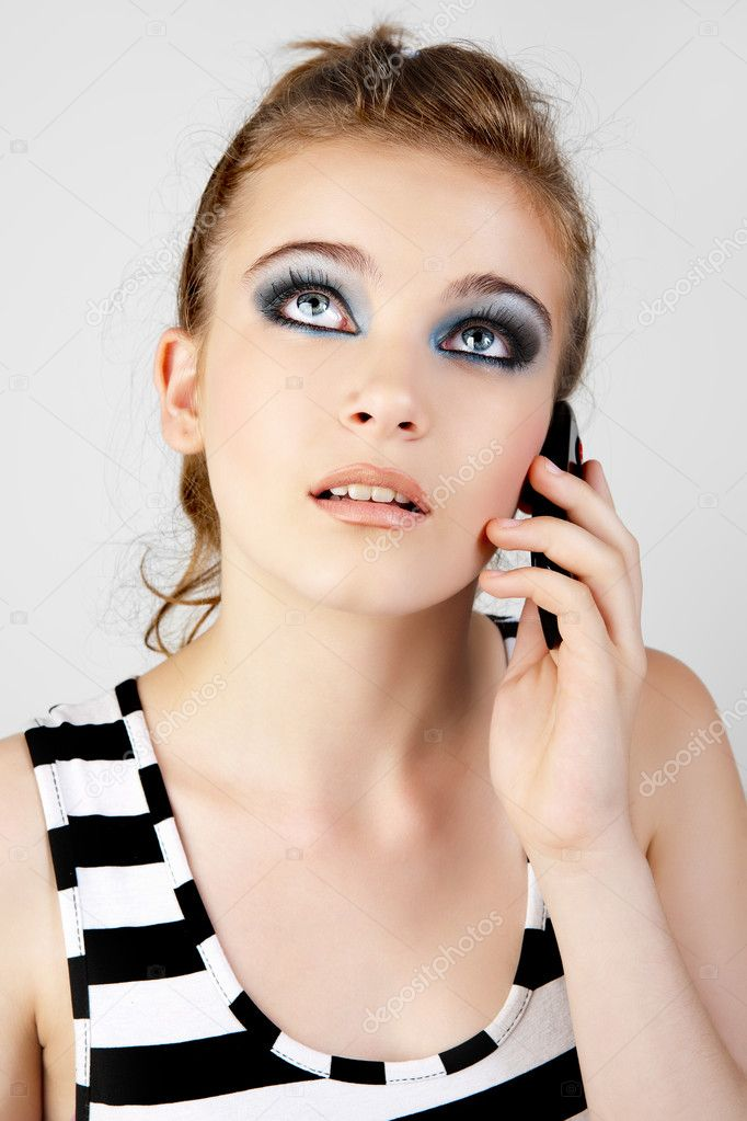 Young and beautiful woman talking on the mobile phone.