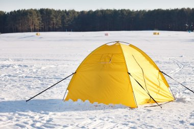 Touristic tent in a winter plain