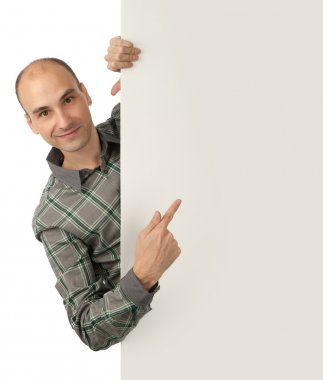 Man pointing at a blank board