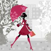 Fotografie Beautiful woman with umbrella
