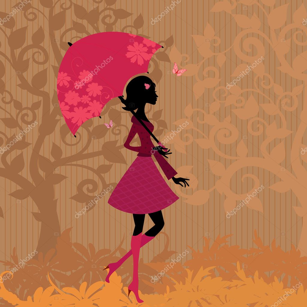 Woman under an umbrella in the autumn