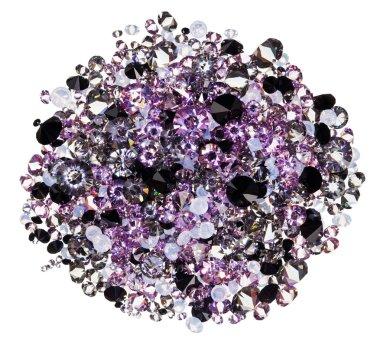 Many small purple diamond (jewel) stones heap isolated on white