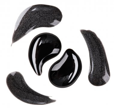 Black and silver nail polish (enamel) drops sample, isolated on