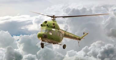 Helicopter MI-2 flight, Russia against clouds