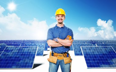 Smiling worker and solar power