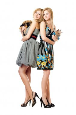 Two beautiful young women with dogs