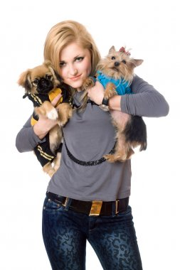 Smiling blonde posing with two dogs