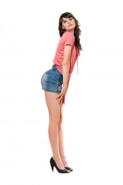Playful girl in jeans mini skirt. Isolated