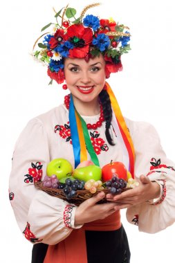 Woman in the Ukrainian national clothes with fruit