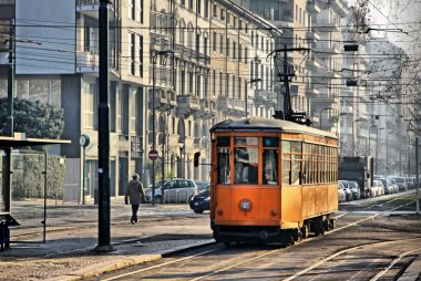 Old vintage orange tram on the street of Milan, Italy