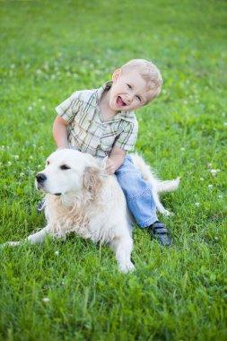 Boy with retriever outdoor