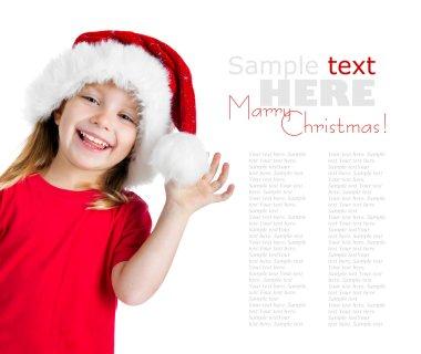 Pretty girl in santa claus hat