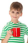 Fotografie Junge hält eine rote Tasse