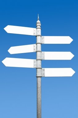 Multidirectional six way signpost with blank spaces for text.