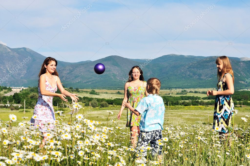 Children playing a ball in fiels