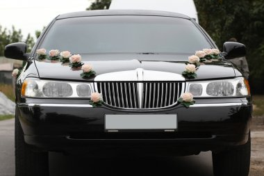 Decorated wedding limousine from the front