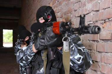 Soldiers in black masks with guns