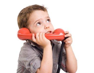 Little gay boy talking on a retro telephone.