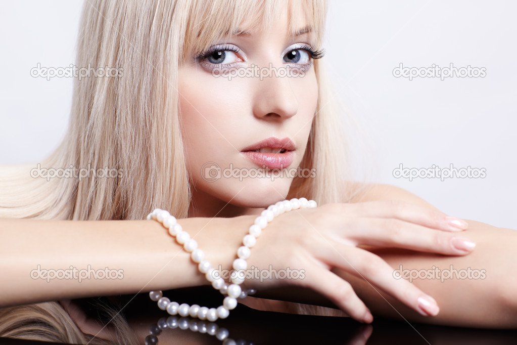 Gorgeous blonde with beads