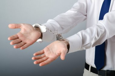 Businessman handcuffed for his crimes