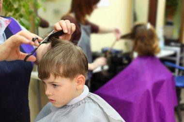 Boy in hairdressing salon