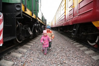 Two children between trains