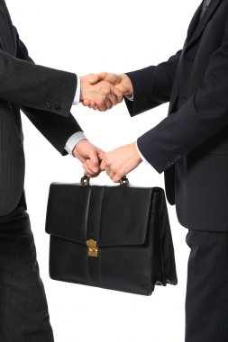 One businessman gives another briefcase