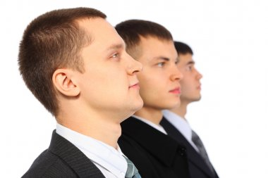 Three businessmen in profile, parody to Marx, Engels and Lenin