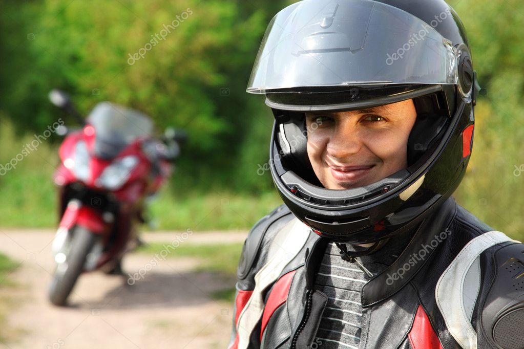 Motorcyclist and his bike on country road