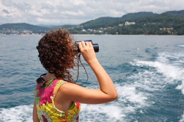 Observing in binocular sea coast
