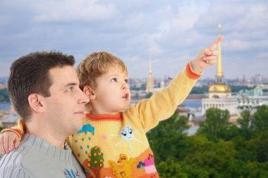 Father with son on historic centre of St.Petersburg background c