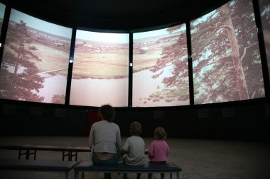 Mother and child in panorama cinema