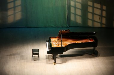 Piano on the scene in the concert hall