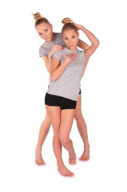 Twin sport girls posing