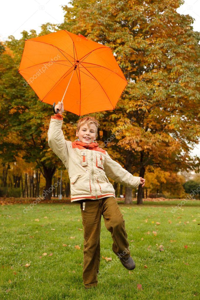 Umbrellas in autumn park