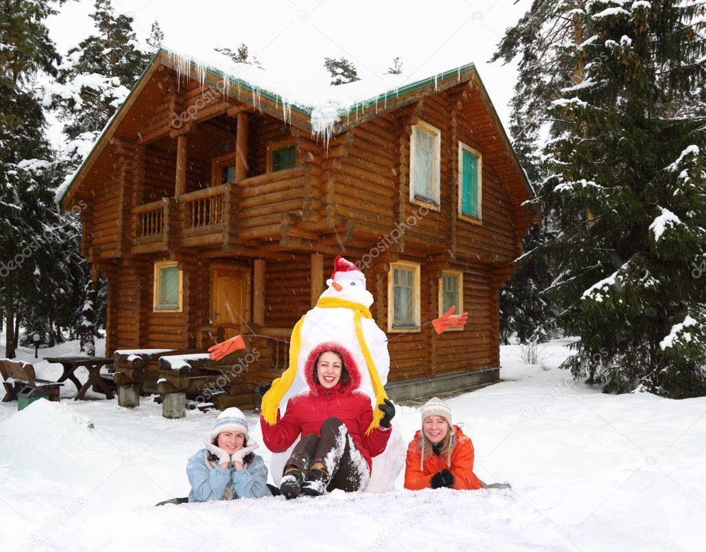 Three girls with snowman and winter house collage
