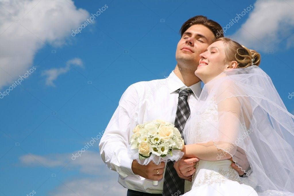 Fiance and bride against the background of the sky