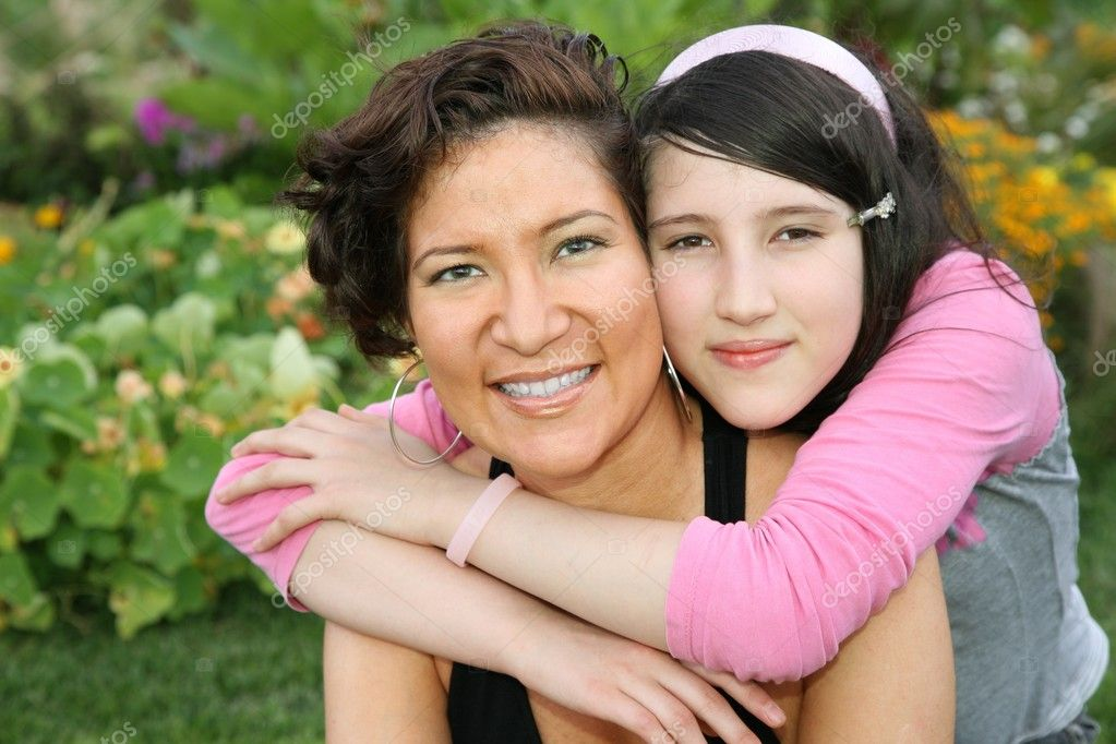 Mother and teenager in park