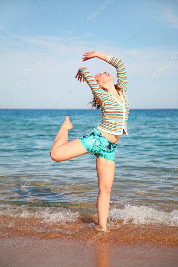 The girl poses on a beach