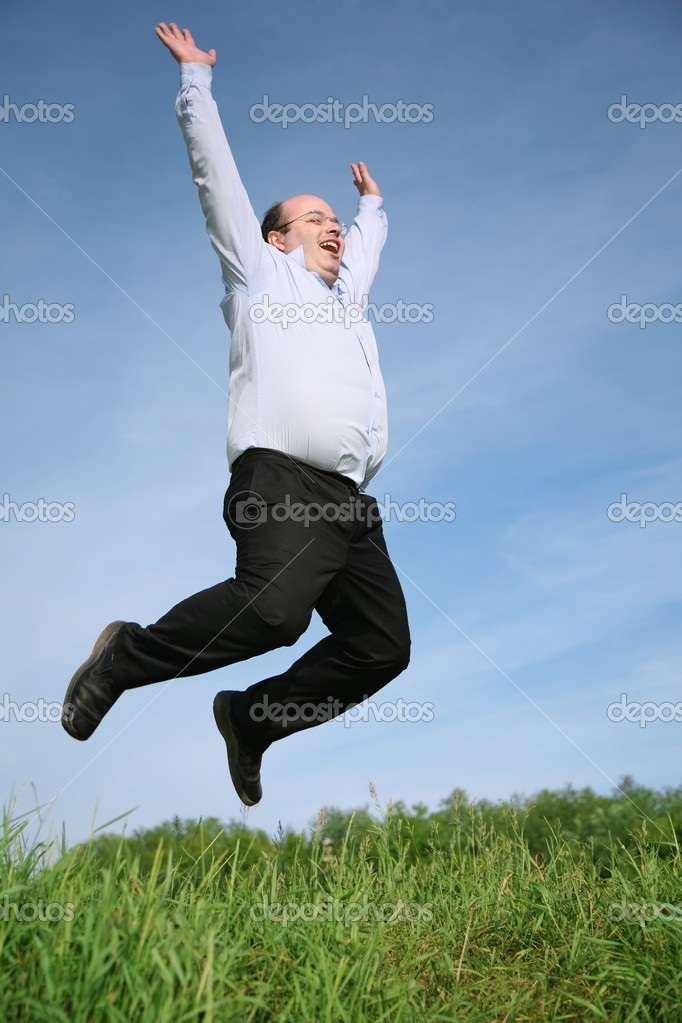 Man jumping grass