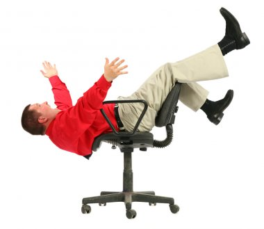 Businessman in red shirt falls from chairs upside down