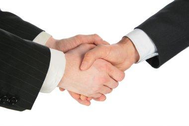 Three handshaking hands