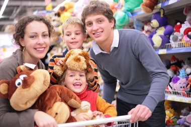 Family in shop with soft toys