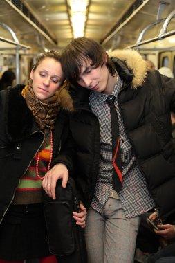 Sleeping pair in subway wagon
