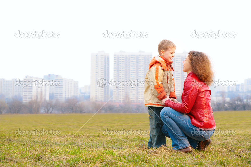 Mother and son look on each other outdoor