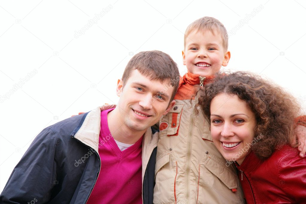 Son embraces parents outdoor