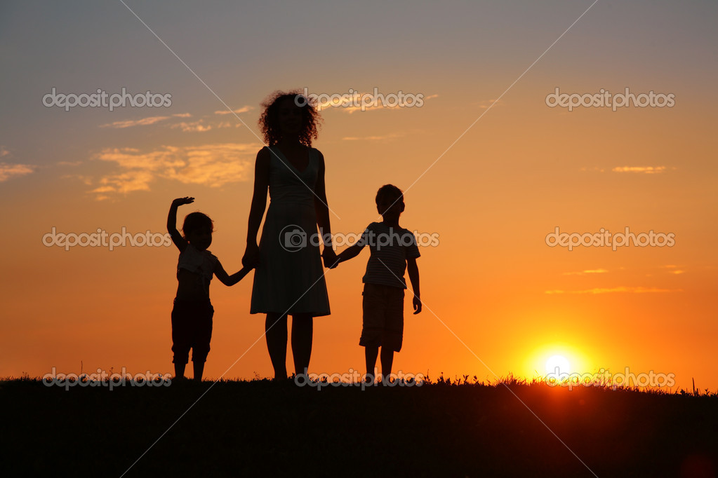 Mother and children on sunset