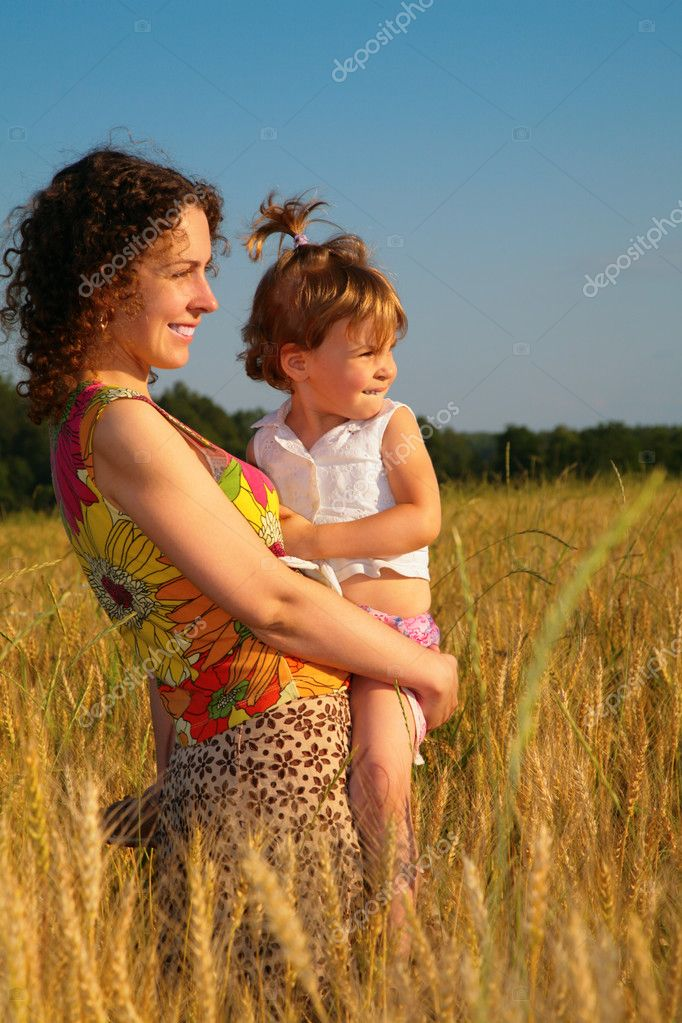 Mother with child on wheaten field