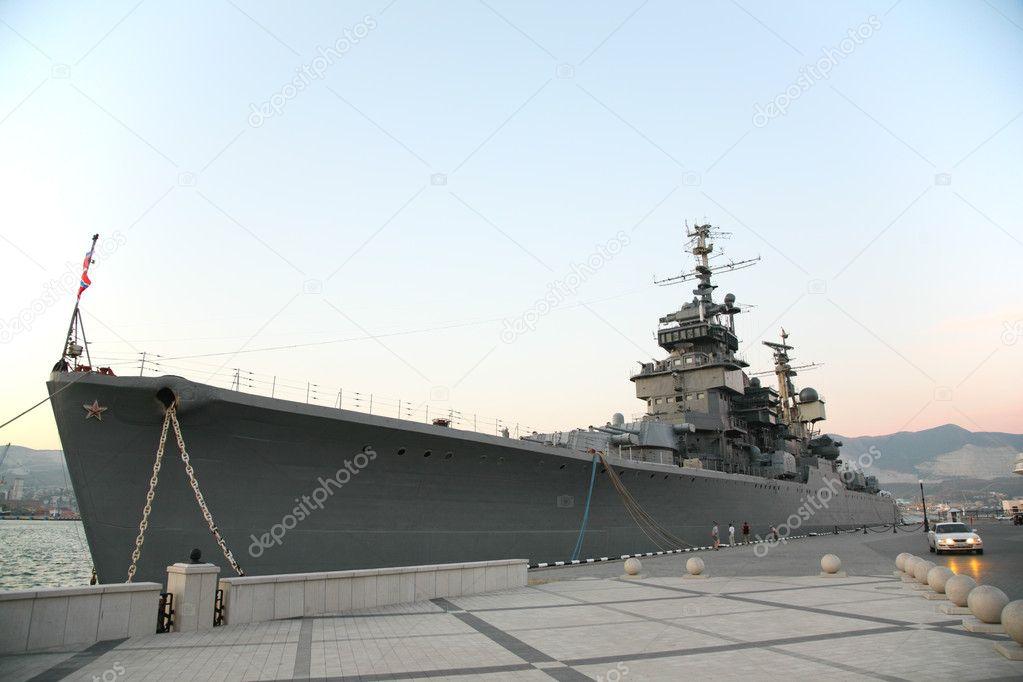 Military ship near pier
