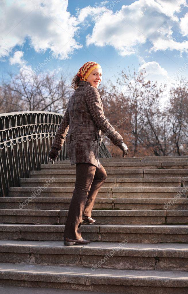 Beauty girl on stone ladder